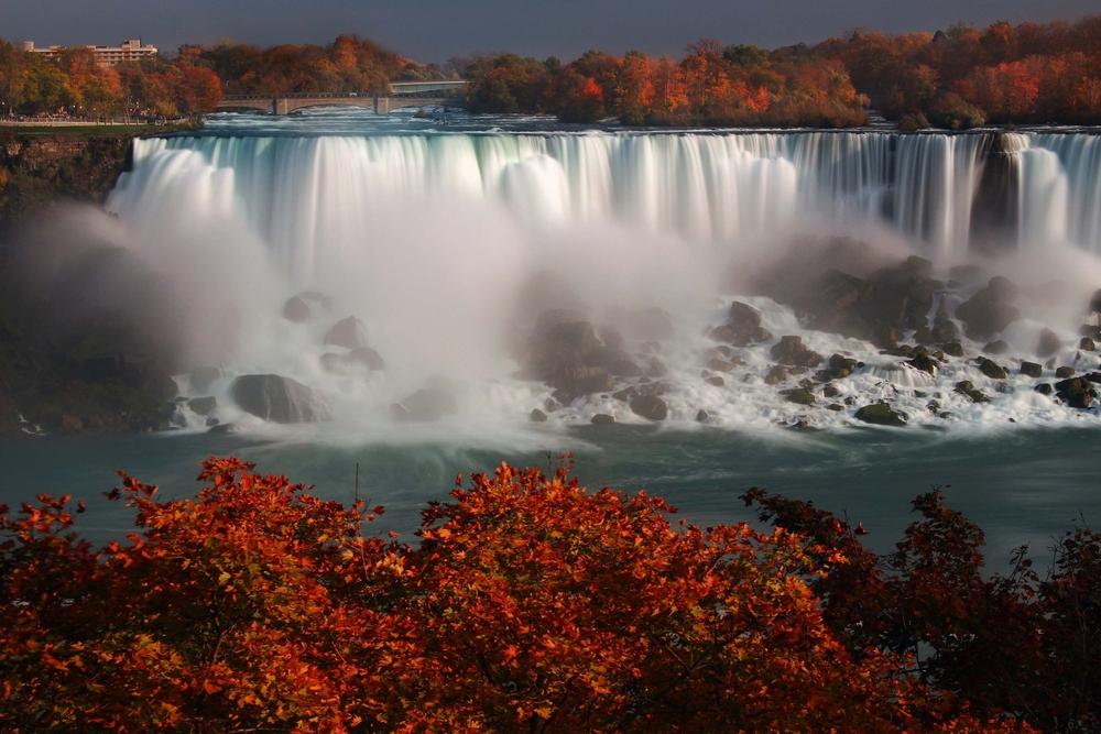 expect beautiful reds to contrast with the blue waters of Niagara falls in canada