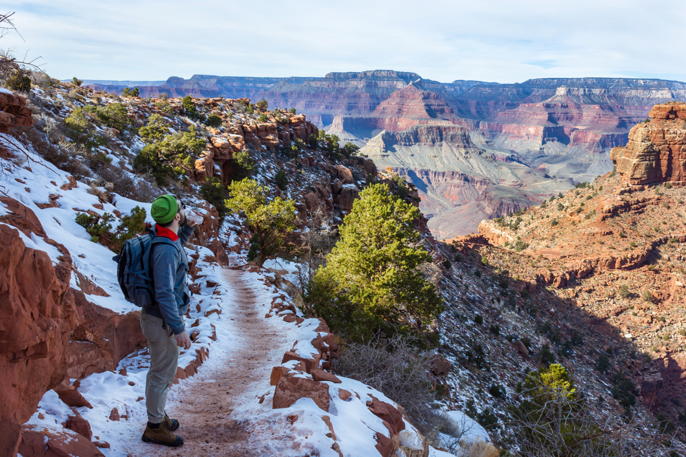start bright angel trail tourist backpacker winter landscape of Grand Canyon National Park's South Rim