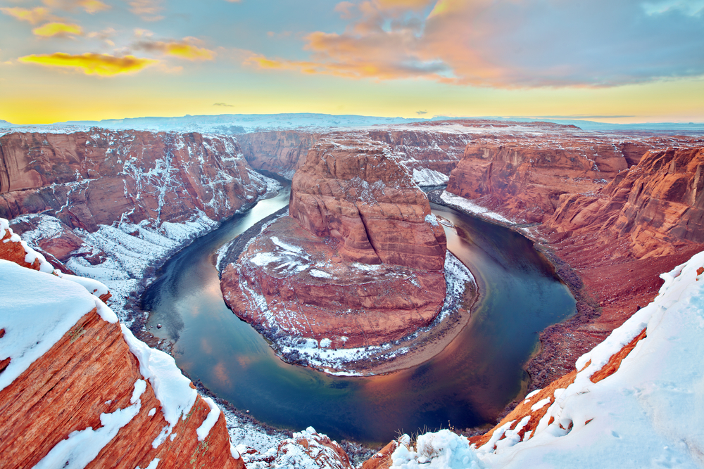 A view of the Grand Canyon in winter covered in snow
