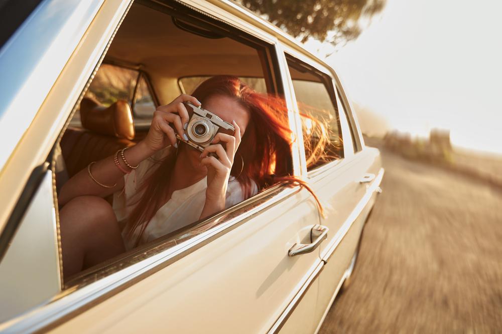 Friends take photo on road trip