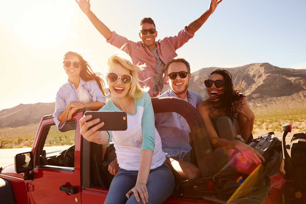 Friends take a selfie on a road trip!