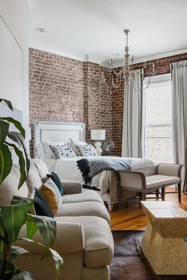 Photo of the inside of a historic Knoxville loft Airbnb showing the bedroom and living room.