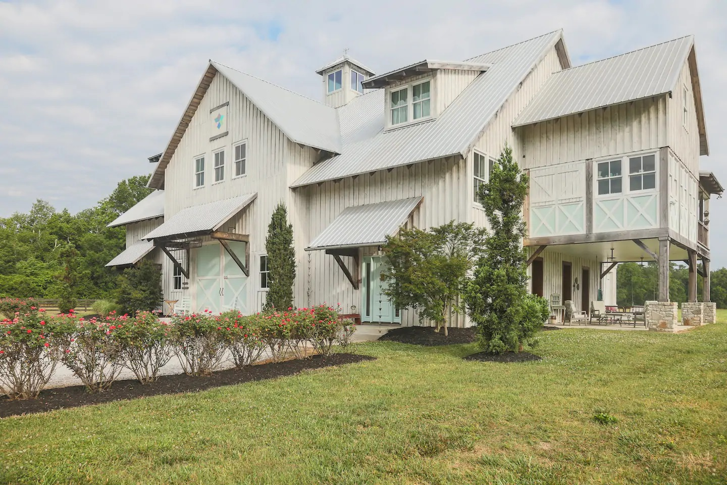 Photo of the exterior of one of the Airbnbs in Tennessee which happens to be a luxury barn.