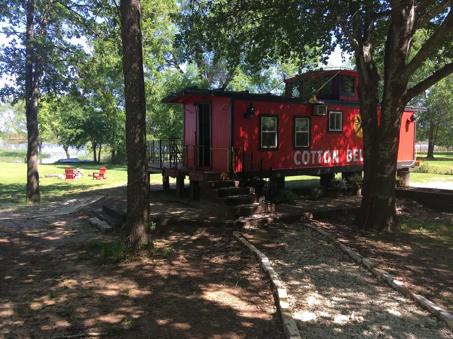 Photo of a red 1920's vintage caboose Airbnb.