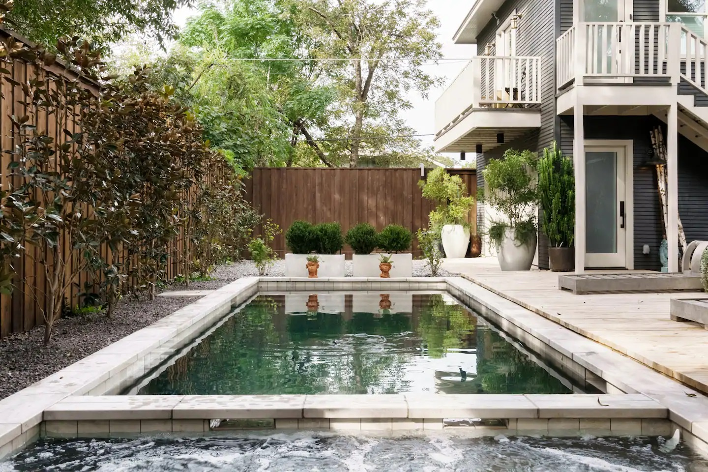Photo of the pool and back exterior of an Airbnb in Dallas.