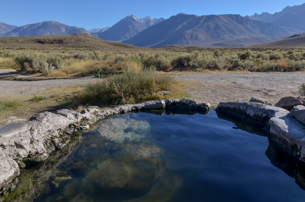 A bright midday view of Whitmore Hot Springs, one of the best natural California hot springs