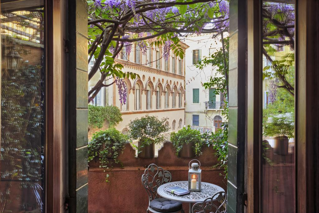 Enjoy the wisteria blooms which make Locanda Fiorita one of the prettiest boutique hotels in Venice