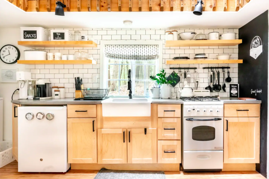 stocked kitchen with light wood and white appliances cabins in the USA