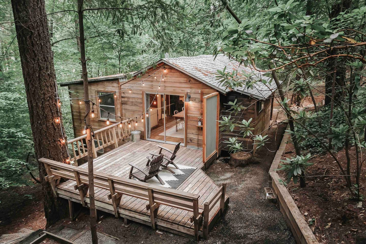 adorable wooden cabin with wooden deck and twinkle lights cabins in the USA