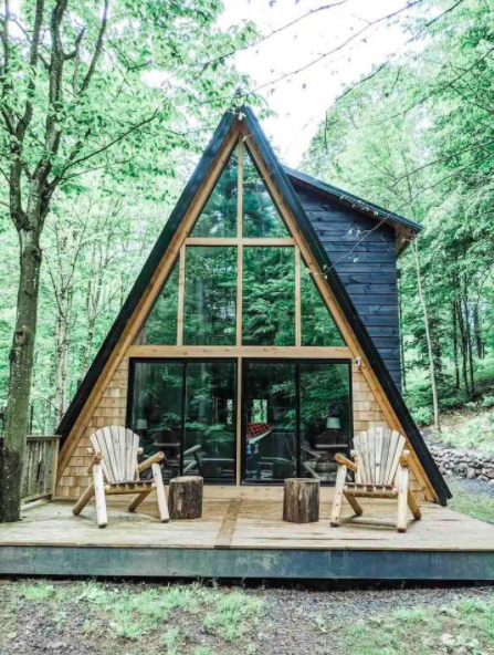 wooden black a-frame with two chairs on front porch
