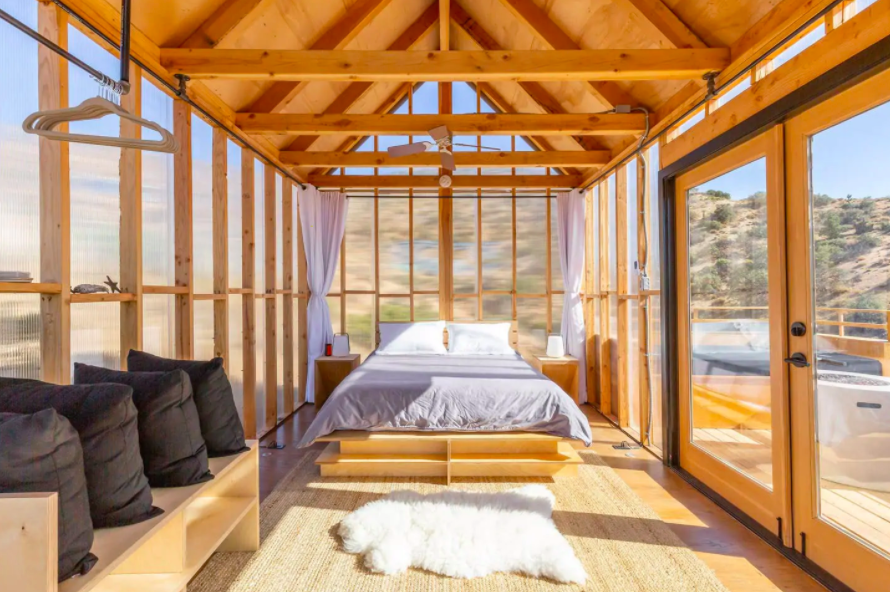 interior of room with wooden frame and completely clear walls cabins in the USA