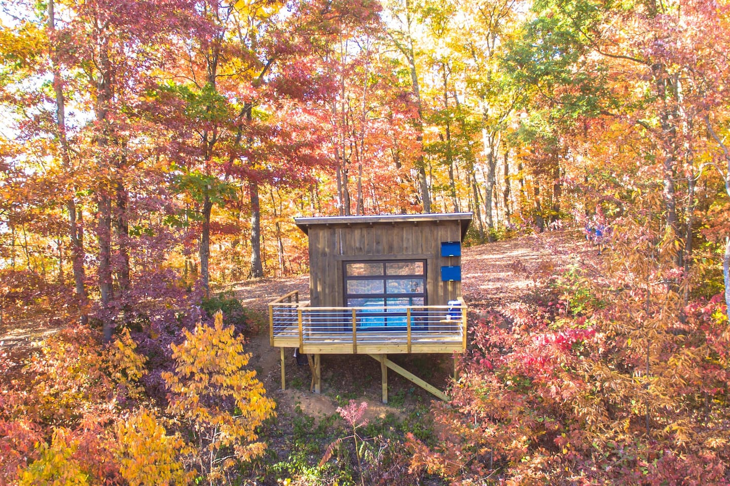 small wooden cabin surrounded by autumn trees cabins in the USA