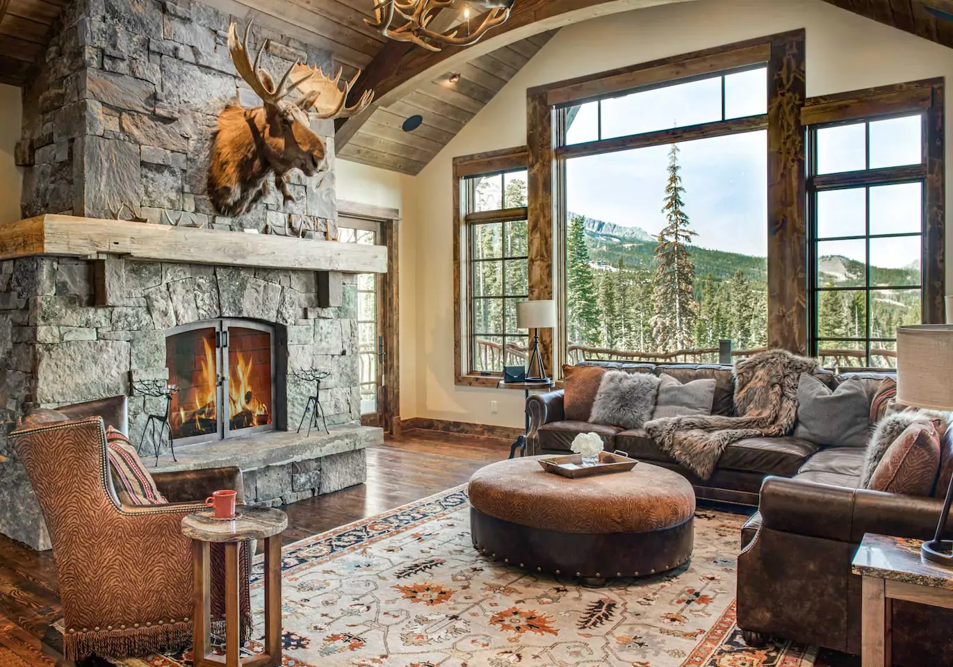 Photo of living room with fireplace inside a mountain chalet Airbnb.