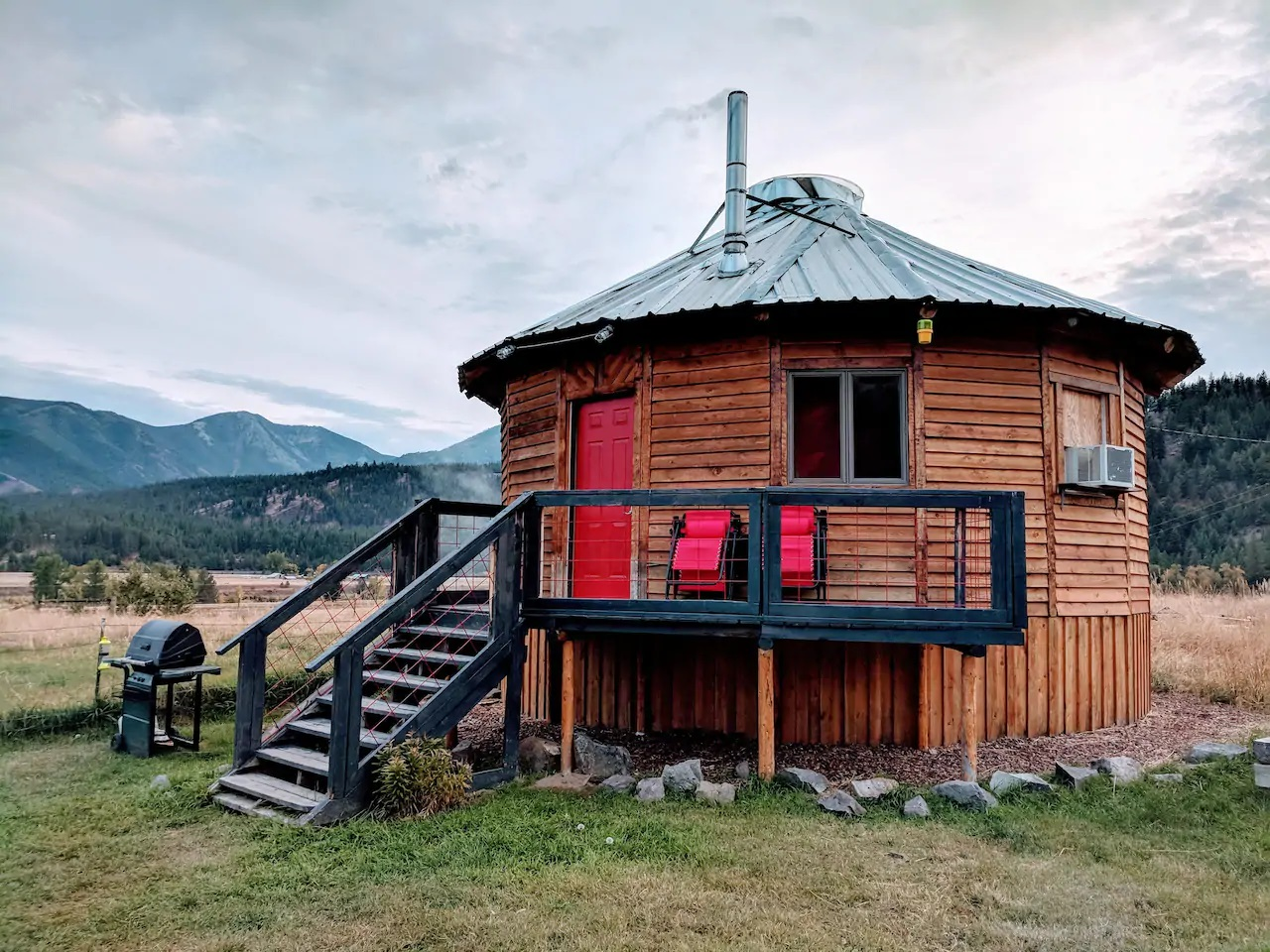 Photo of the outside of a yurt Airbnb.