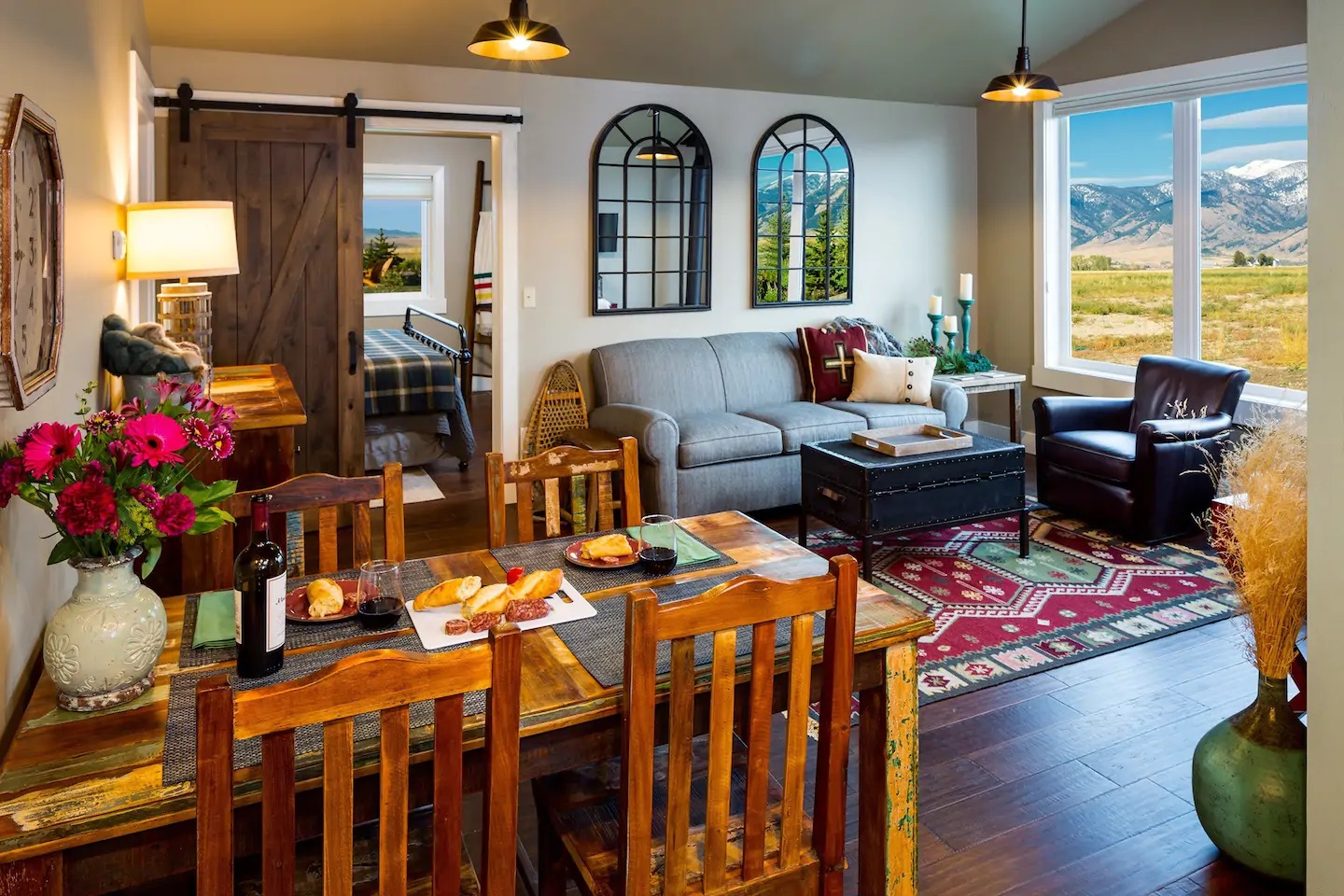 Photo of a living room and dining table inside an Airbnb located in Belgrade, Montana.