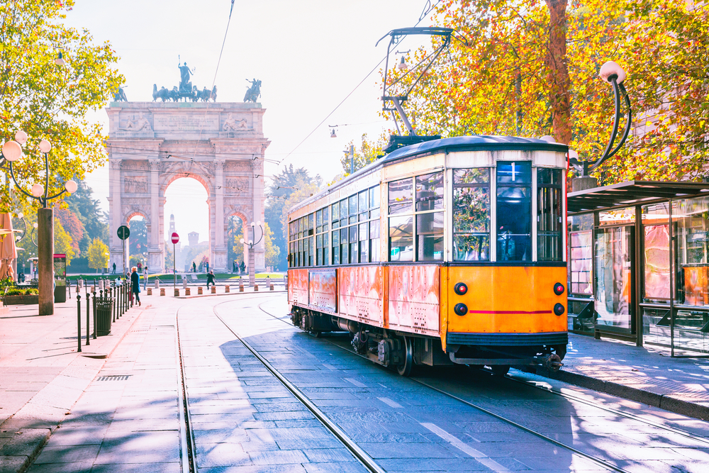 Milan city with a tram in an article talking about Boutique Hotels in Milan