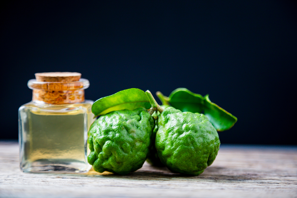 Bergamot essential oil on a wood surface