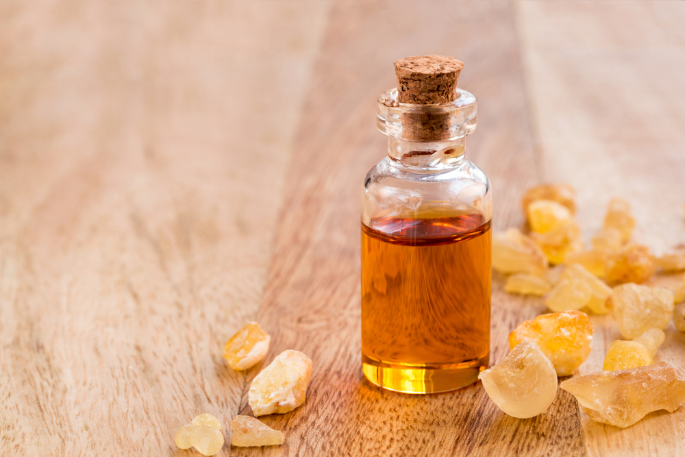 Frankincense on a wooden table and in a  bottle