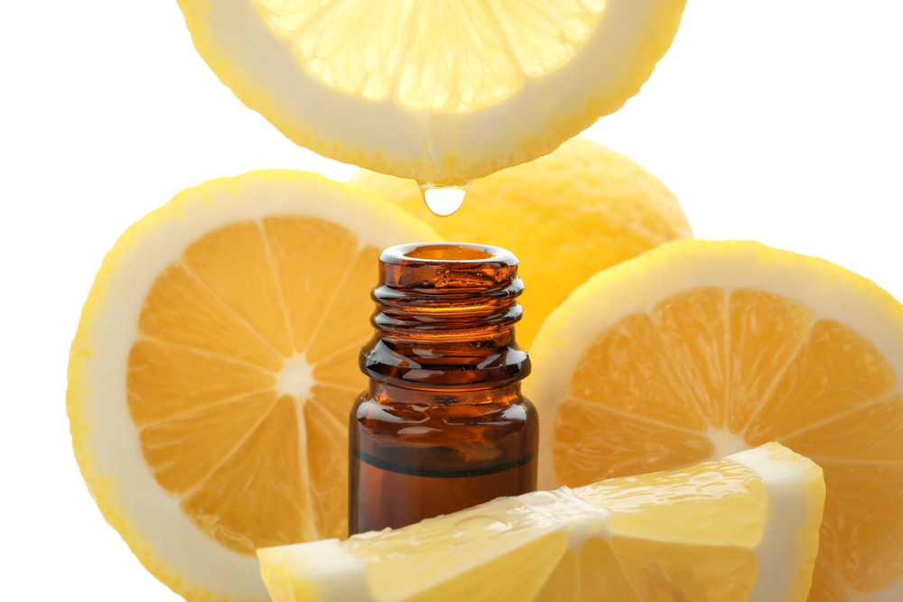 lemons dripping into a bottle