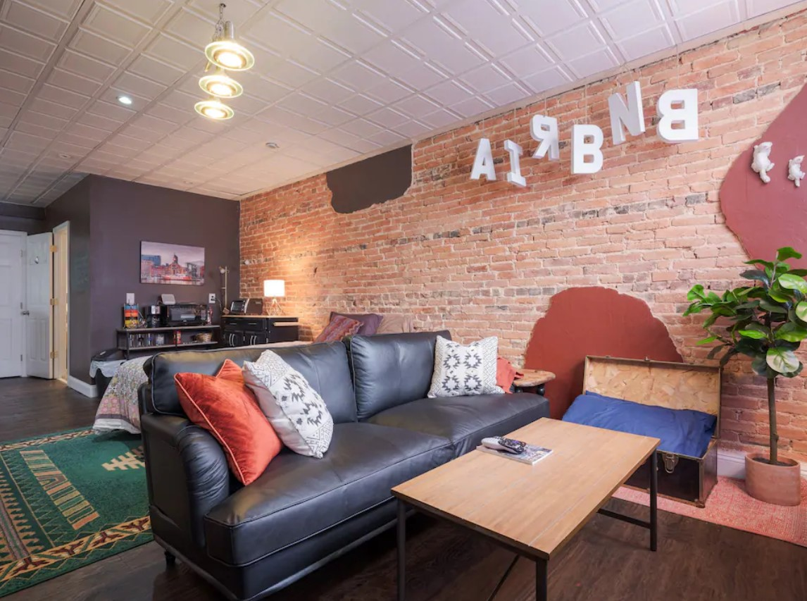 Sitting area in apartment with exposed brick wall