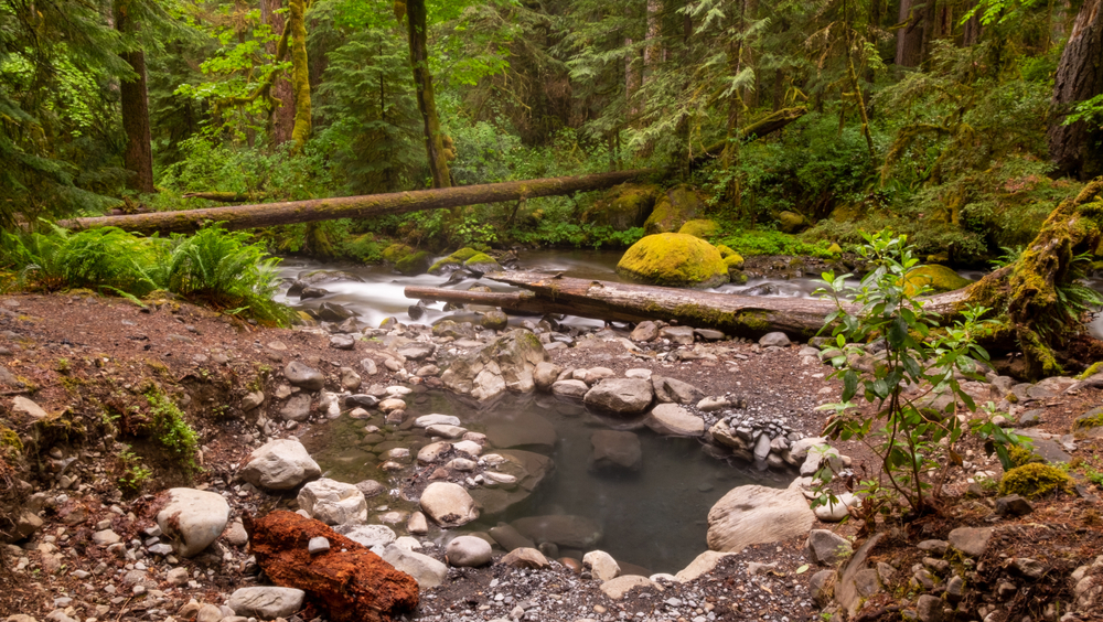 Wall Creek is located on rocky banks and is beautiful for a soak after a hike.