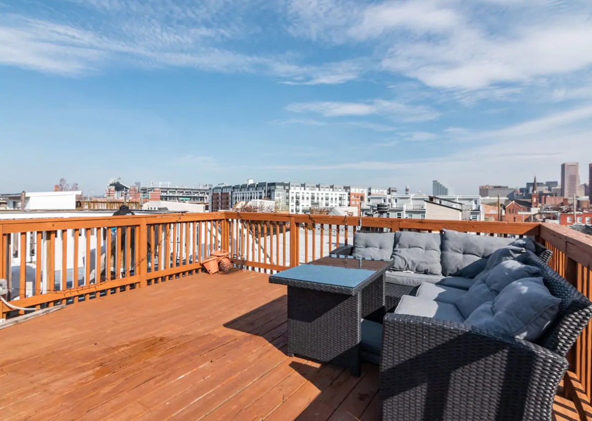 Private rooftop deck with a view of downtown baltimore