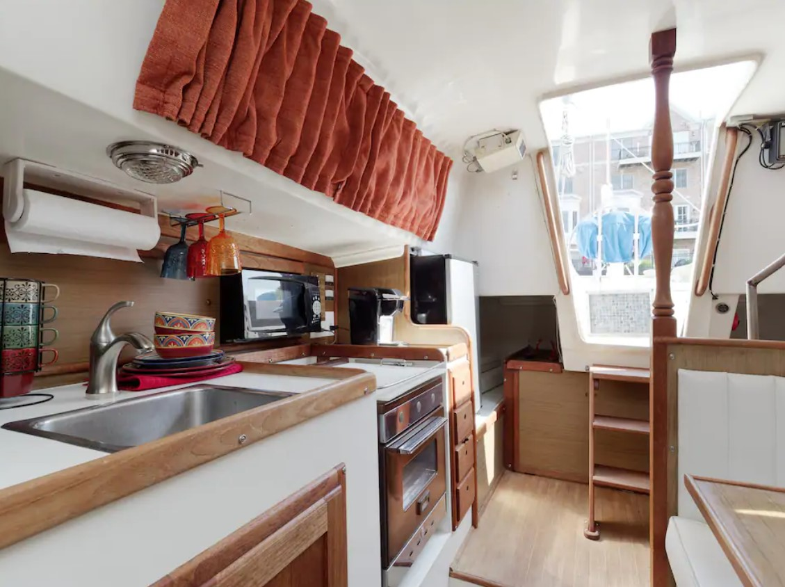 Kitchenette inside a sailboat in one of the best airbnbs in baltimore