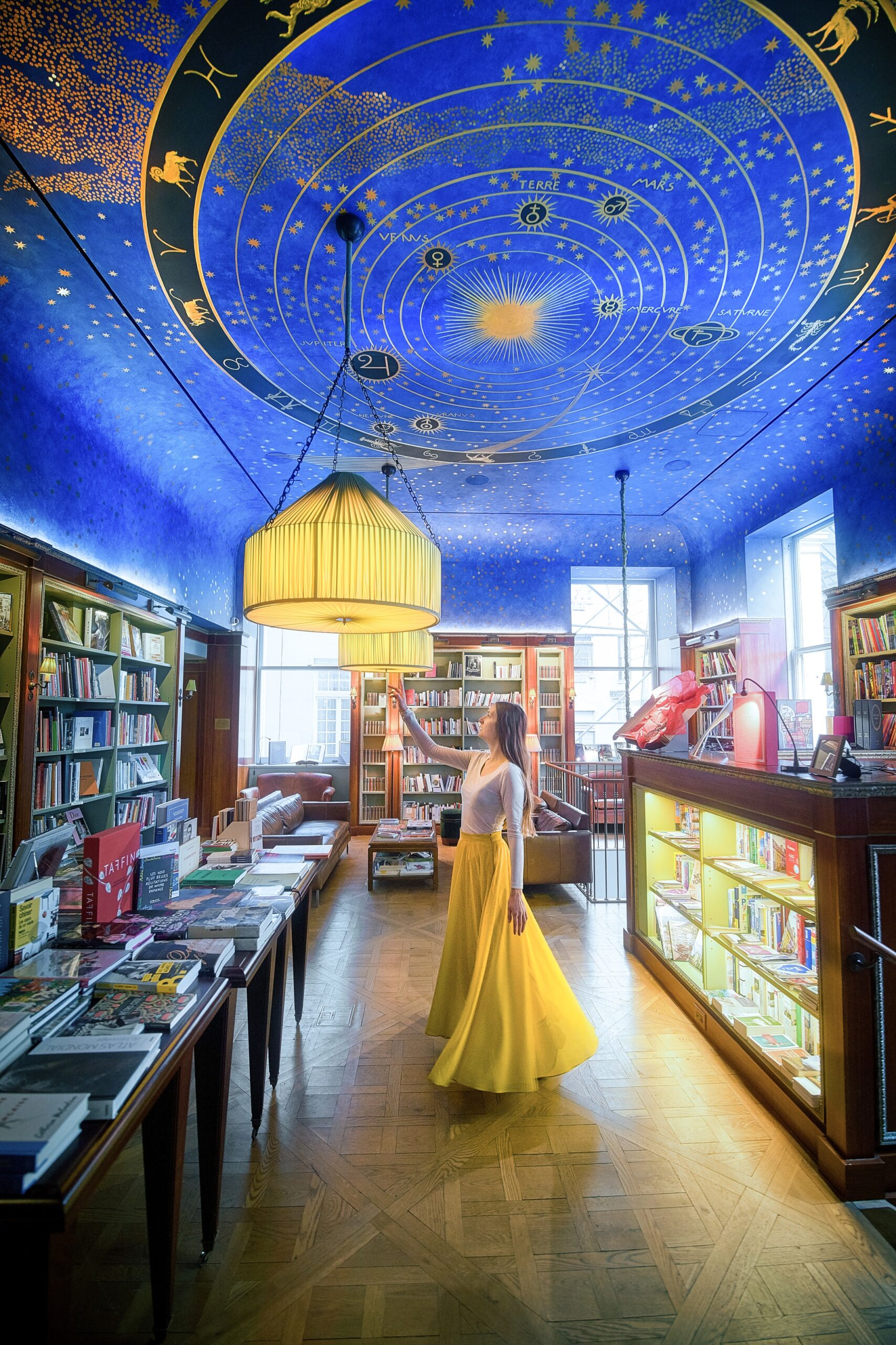 Woman in Albertine books wearing a yellow skirt, one of the most unusual things to do in New York