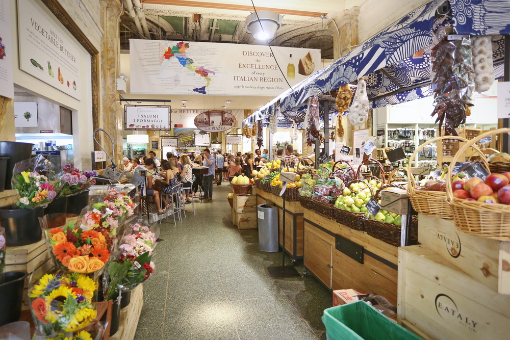 Food and flower stalls in Eataly, a large Italian grocery store, one of the most unusual things to do in New York