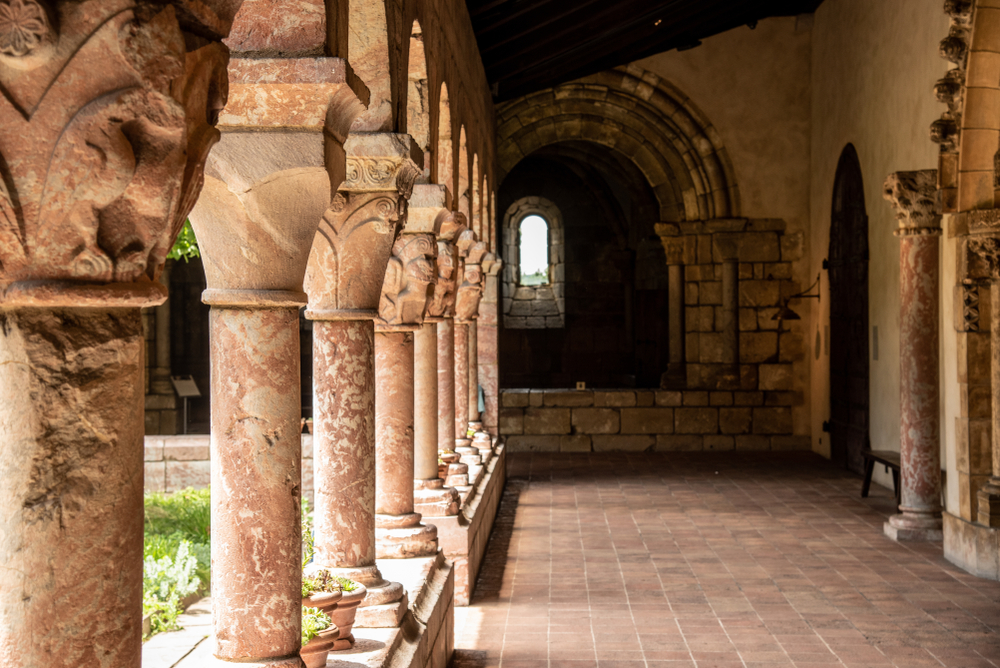 A passageway with columns at the MET Cloisters, one of the most unusual things to do in New York