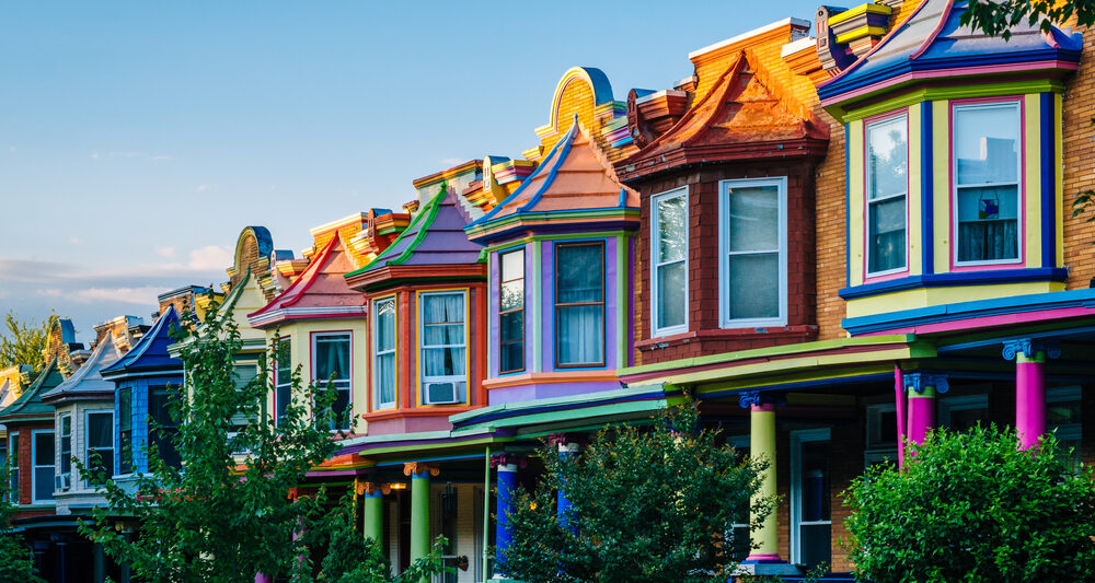 Colorful street of row homes best airbnbs in baltimore