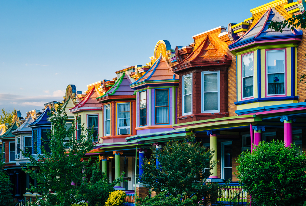 Colorful row homes in baltimore one of the best airbnbs in baltimore