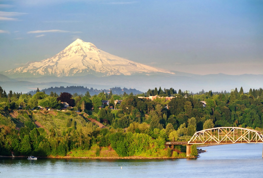 a scenic bridge lots of trees and and Mt Hood in the distance, enjoying nature is one of the best things to do in Portland, Oregon