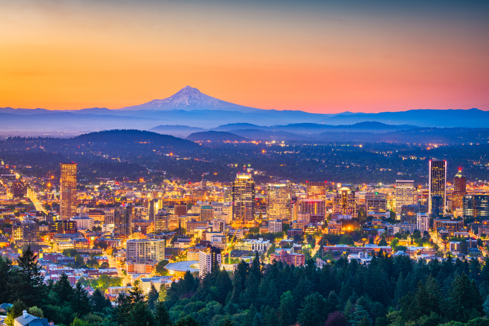 The Portland city skyline at sunset with beautiful Mt Hood visible in the background.