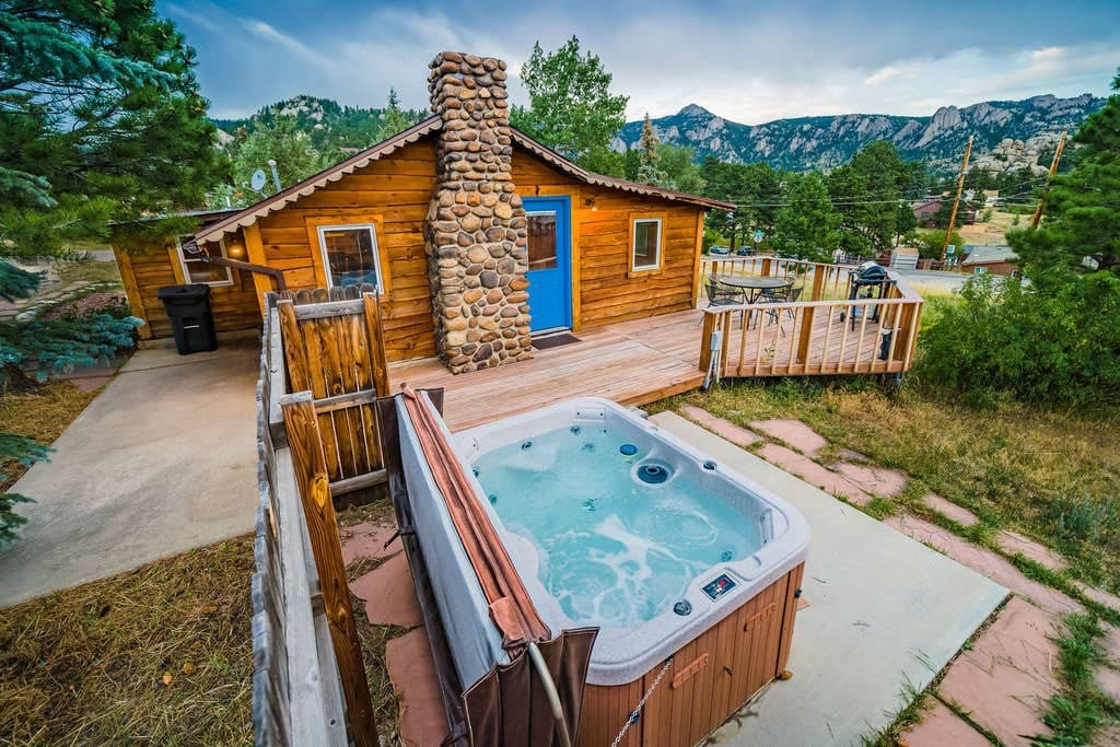 a photo of a historic hillside cabin, a great Airbnb if you're wondering where to stay in Estes Park