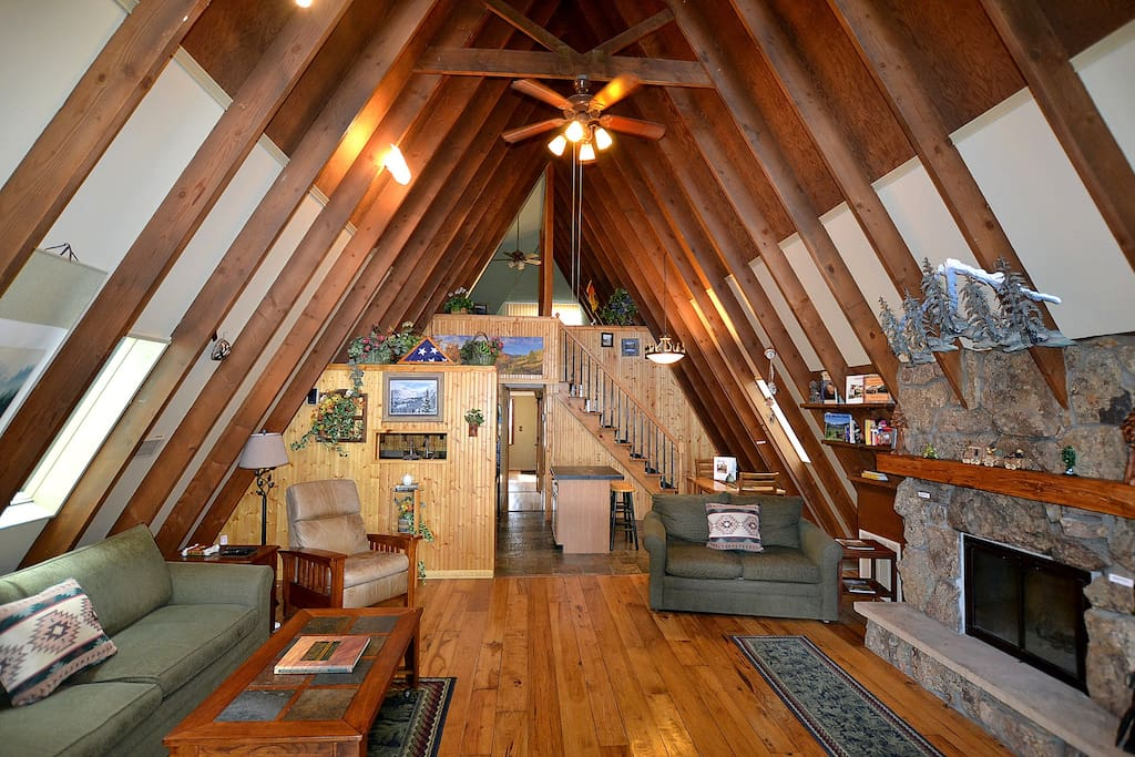 a photo of the inside of a peaceful a-frame cabin, one of the top cabins in Estes Park