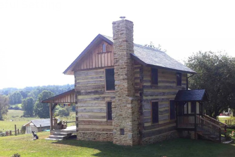 Old two story log cabin on working farm