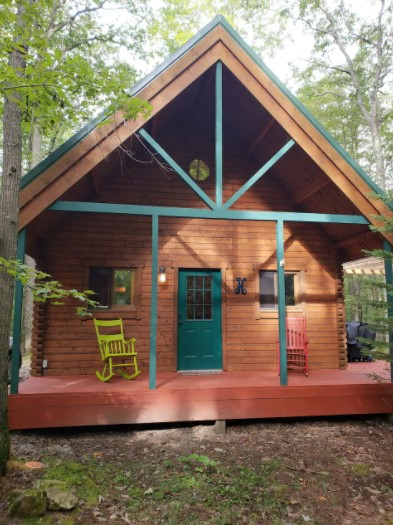 View of the front porch of a secluded log cabin
