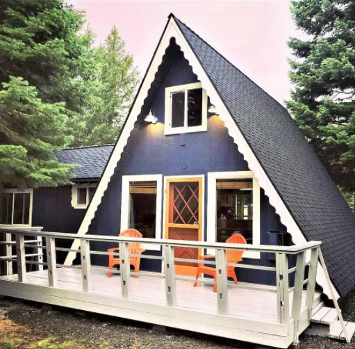 Cute little A-frame cabin with a small front porch and cottage style decorations one of the best cabins in Idaho
