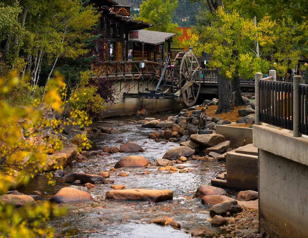 photo of a water wheel in downtown Estes Park, a place where you can find some awesome Estes Park Airbnbs