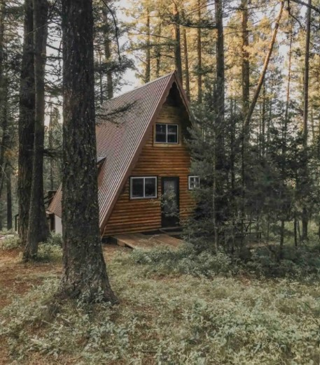 Secluded A-frame cabin surrounded by lush forests one of the best cabins in Idaho