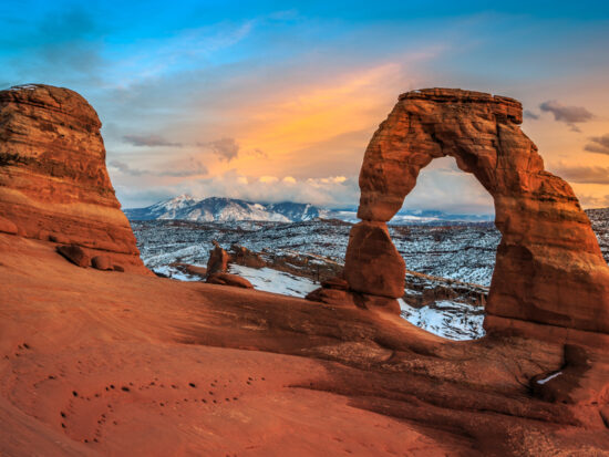 a photo of arches national park in winter, a great time to visit