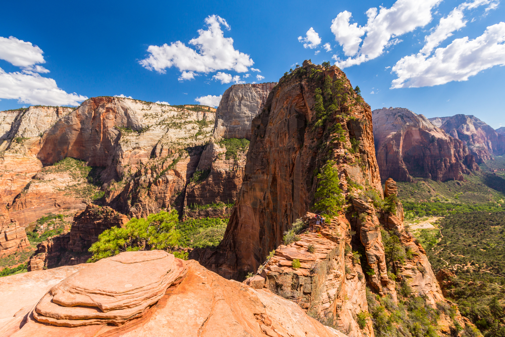 The view of Angel's Landing with large rock formations in the background, one of the best hikes in the usa