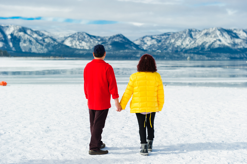 A couple looking out at Lake Tahoe in the winter