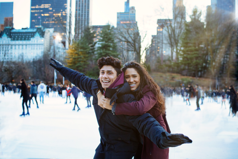 A couple ice skating at Rockefeller Plaza in New York City