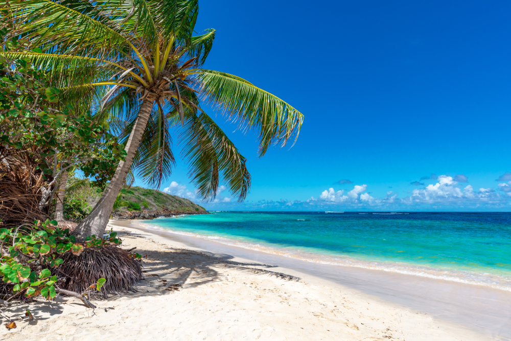 Beautiful beach with white sand and crystal blue waters in Puerto Rico one of the best honeymoons in the usa