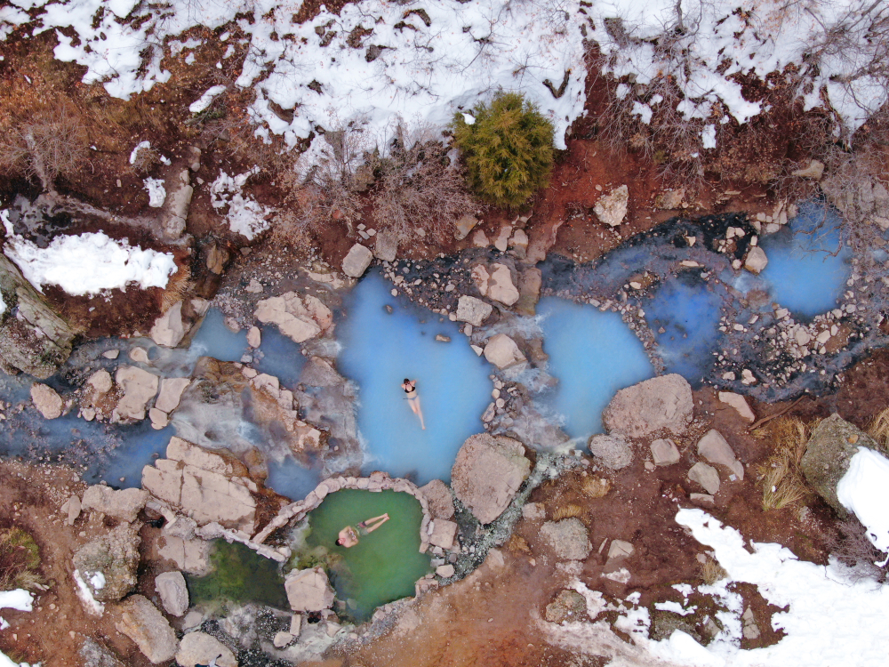An overhead image of people bathing in the Diamond Fork Hot Springs one of the best hikes in the usa