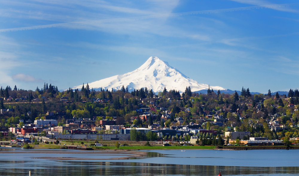 A view of Hood River from the water with Mt. Hood looming behind it.