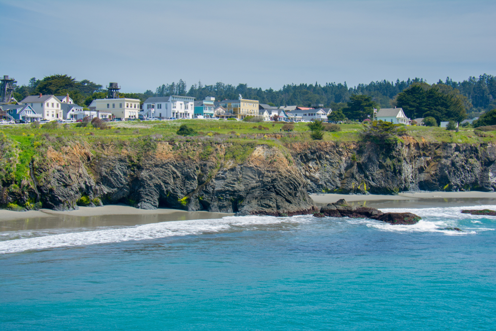 View of Mendocino California from the water looking at the cliffs and houses, one of the cutest small towns on the West Coast