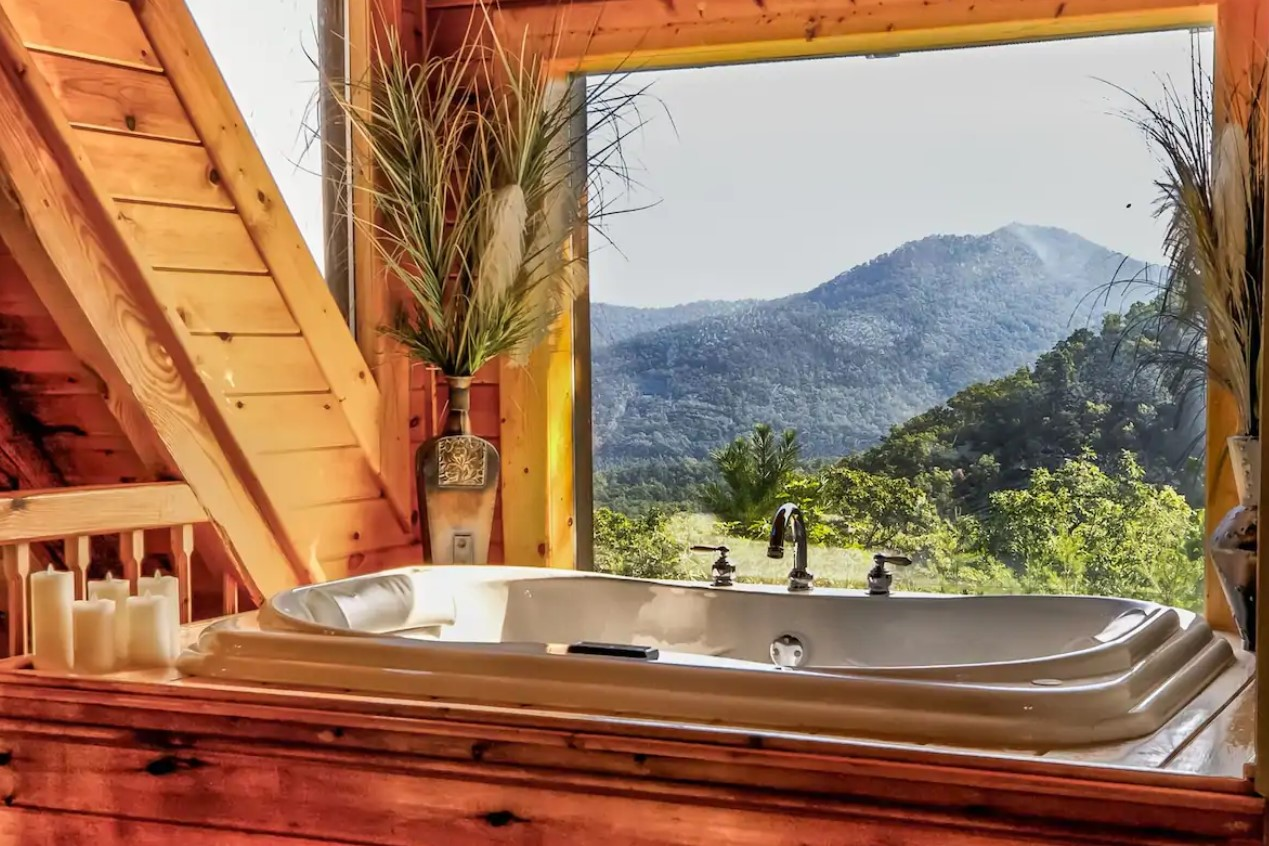 The view of the Great Smoky Mountains from a jacuzzi tub in one of the coziest cabins in the South